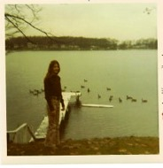 Kelly Flynn at her home on Lake Fenton, near the public access, circa 1971. (Homemade surfboard floats near the dock.)